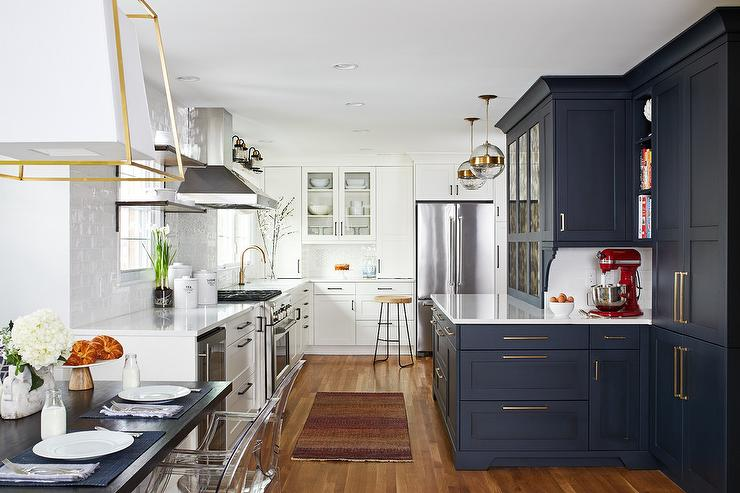 Two-Tone Kitchen: Blue Shaker Cabinets with Brass Pulls and White Shaker Cabinets with Oil Rubbed Bronze Pulls. Design by Jack Rosen.