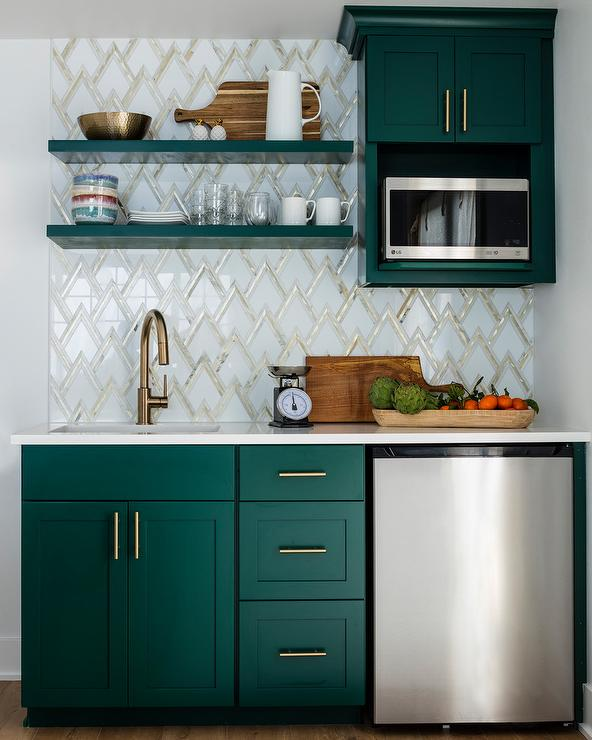 Hunter green shaker cabinets with brass pulls and white quartz counters. Design by Kimberlee Marie Interior Design